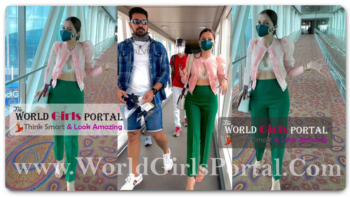 Rubina Dilaik green stylish trousers and paired it with a white chic bralette, pastel pink sheer jacket style shirt, Rubina Dilaik as she is all set to travel with her hubby