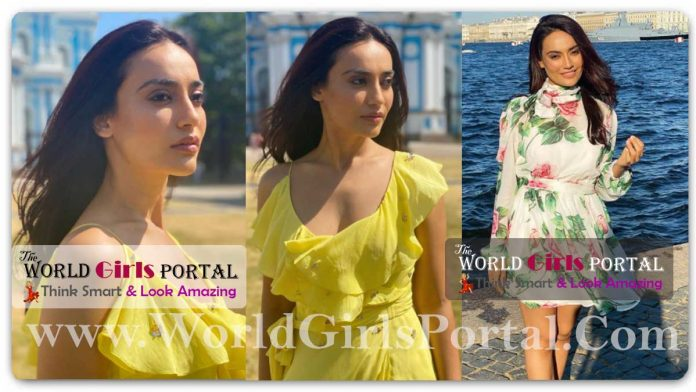 Surbhi Jyoti sunshine yellow asymmetrical wrap-around dress with a flared pleatsaround the neckline Looking Simple Style but Gorgeous