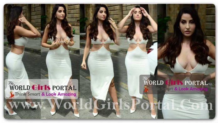 Nora Fatehi Show Sexy Curve in her cleavage-baring white cut-out dress #BodyconDress Bollywood Belly Dancer Girl Nora Fatehi Fashion News