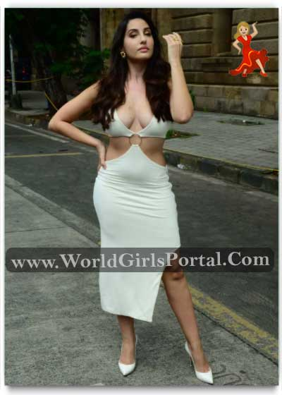 Nora Fatehi grabbed eyeballs as she stepped out in a deep plunging neckline bodycon dress flaunting her sexy figure; take a look at her pictures